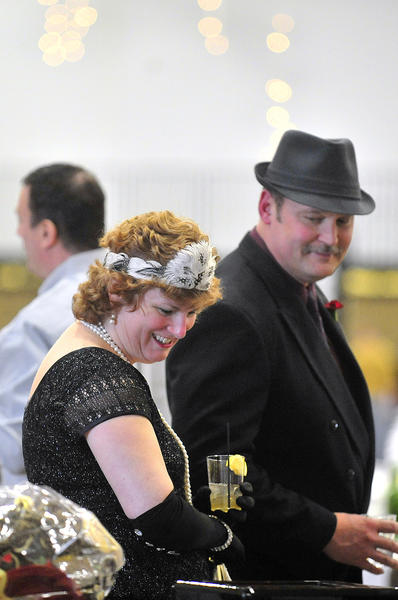 Pam and Craig Mohn of Williamsport look through the silent auction items at the 20th annual Habitat for Humanity of Washington County Dinner-Auction Saturday. This year the theme celebrates the roaring 20's.