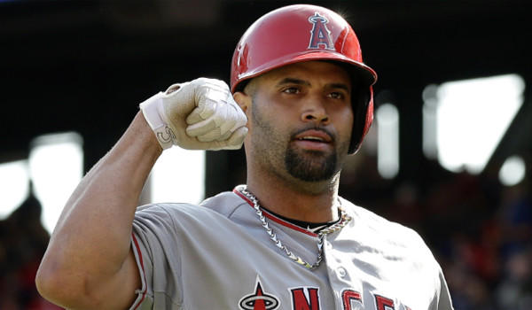 Albert Pujols celebrates after one of his two home runs during the Angels' 8-4 victory over the Rangers on Saturday.
