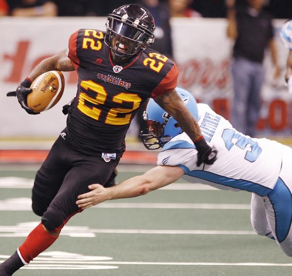 Orlando kick returner Dominic Jones (22) evades Philadelphia kicker Carlos Martinez (3) as he runs a kick back for a touchdown during the Philadelphia Soul at Orlando Predators AFL game at the Amway Center in Orlando on Saturday, April 6, 2013.