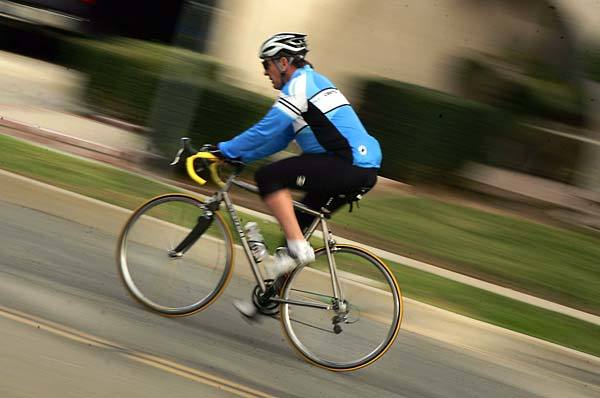 <b>CUSTOM-MADE:</b> Bob Perkins, 54, rides his titanium bike in Simi Valley. Boomers like Perkins are taking up road cycling as a low-impact alternate to running.
