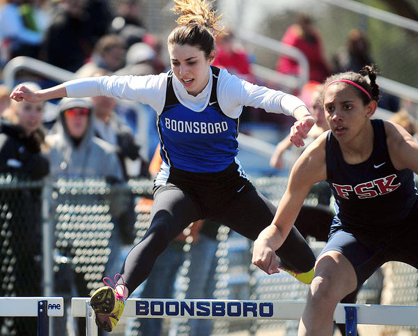 Boonsboro's Maggie Sullivan, left, comes from behind to edge Francis Scott Key's Jordan Fine for the victory in the girls 100-meter hurdles Saturday at the Dwight Scott Invitational.