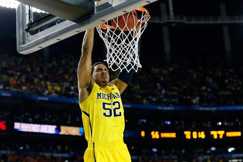 Michigan forward Jordan Morgan puts down a breakaway dunk in the final seconds to seal a 61-56 victory over Syracuse in an NCAA tournament Final Four game on Saturday night at the Georgia Dome in Atlanta.