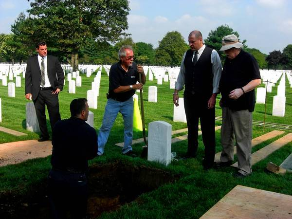 Family attorney James Culp, second from right, was on hand when Kyle Antonacci's body was exhumed in 2010.