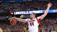 ATLANTA -- Luke Hancock came off the bench to score 20 points, walk-on Tim Henderson sparked a second-half rally with a pair of monster three-pointers and Louisville advanced to the NCAA title game Saturday night, escaping with a 72-68 victory over Wichita State.
