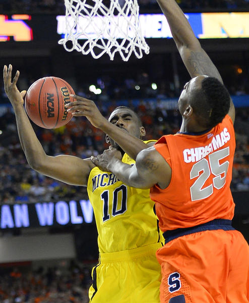Tim Hardaway Jr. (10) of the Michigan Wolverines is fouled as he shoots against Rakeem Christmas (25) of the Syracuse Orange in the second half in an NCAA Final Four semifinal at the Georgia Dome in Atlanta, Georgia, Saturday, April 6, 2013. (Harry E. Walker/MCT)