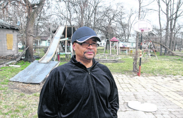 Stanley Bryant stands in the old playground his father built. The older Bryant died Friday night after a fire broke out in his home. Firefighters have yet to determine the cause of the blaze.
