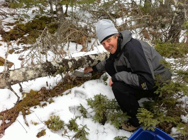 Harbor Day School science teacher Jean-Paul Rimlinger sets a trap for small mammals in Nova Scotia where he spent a week helping scientists track the mammal population.