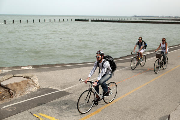 Bike riders make their way north along the lakefront path on April 6. (Anthony Souffle/Chicago Tribune)