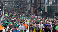The Shamrock Shuffle, a race expected to draw tens of thousands of runners to downtown Chicago, is experiencing an emergency re-route this morning because a man was threatening to jump from the State Street bridge and police closed off that part of the race's route.