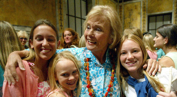 Notable deaths from 2013: Fashion designer Lilly Pulitzer, center, hugs her granddaughters after presenting her spring collection at the New York Public Library. Pulitzer passed away at age 81 at her home in Florida.