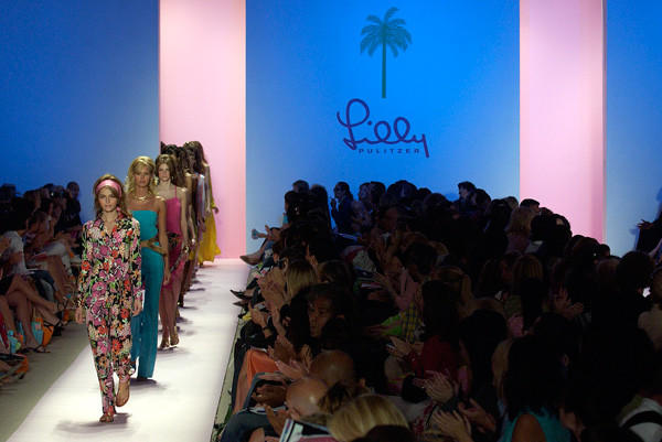 Models walk out together at the end of contemporary fashion designer Lilly Pulitzer's Spring 2005 fashion show in New York on Sept. 12, 2004.