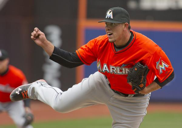 Miami Marlins starting pitcher Jose Fernandez follows through on a pitch to the New York Mets in the third inning of their MLB National League game at CitiField in New York, April 7, 2013. REUTERS/Ray Stubblebine (UNITED STATES - Tags: SPORT BASEBALL) ORG XMIT: NYM02