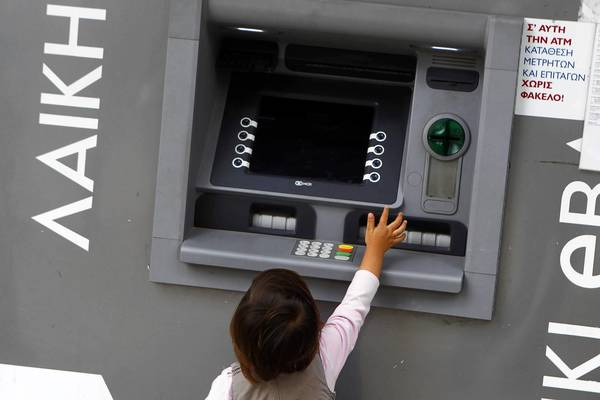 A child plays with an ATM in Cyprus, a country hit by a banking crisis. Its banks have been used by people in other nations to hide money, and millions of dollars have been lost.