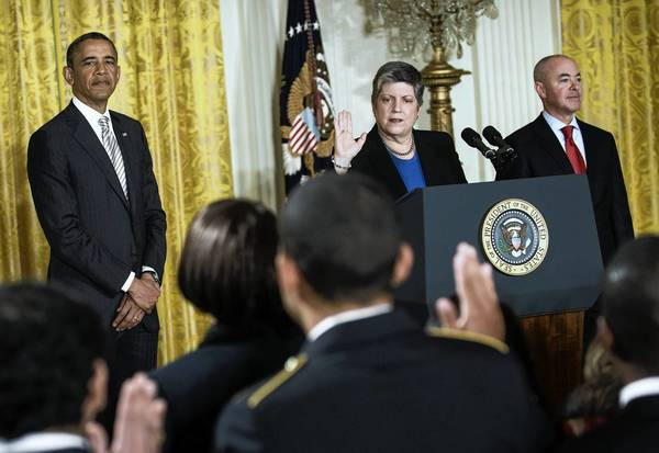 President Barack Obama and Alejandro Mayorkas, right, director of U.S. Citizenship and Immigration Services, listen as Secretary of Homeland Security Janet Napolitano administers the oath of allegiance during a naturalization ceremony at the White House last month.