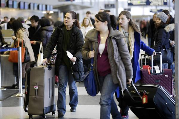 Customers who experience flight cancellations, as these travelers did at O'Hare International Airport after a storm last month, often blame the airline for the delay.