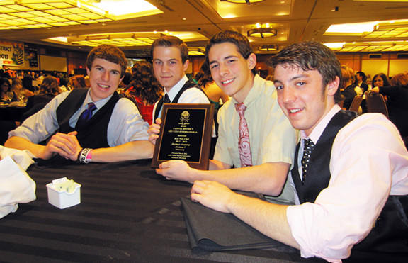 Heritage Academy students, from left, Tristan Prejean, Bryce Nigh, Abraham Strickler and Collin Poyle display Heritage Academy Key Club's Best New Club award, which was presented at the Capital Key Club District Leadership Conference March 8 to 10 at the Hyatt Regency Inner Harbor in Baltimore.