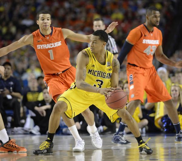 Trey Burke leads Michigan against Louisville in the NCAA title game Monday.