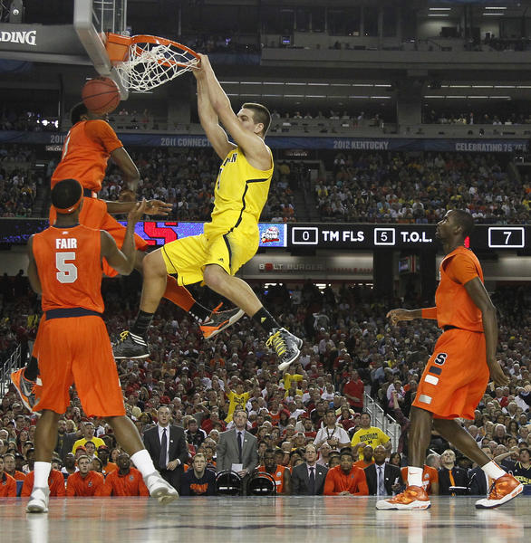 Michigan's Mitch McGary dunks against Syracuse in Saturday's semifinal.