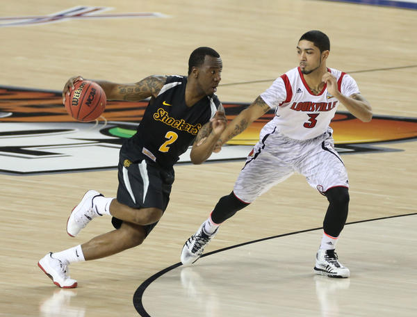 Wichita State Shockers guard Malcolm Armstead drives against Louisville guard Peyton Siva.