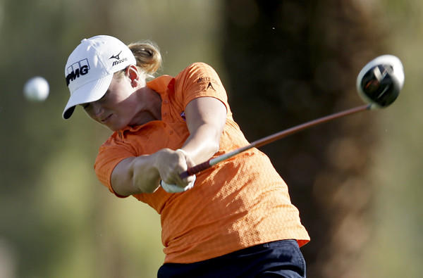 Stacy Lewis hits her drive at No. 11 during the first round of the Kraft Nabisco Championship on Thursday.