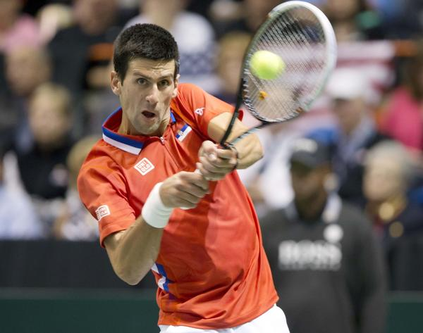 Novak Djokovic returns a shot during his match Sunday against Sam Querrey in the Davis Cup.