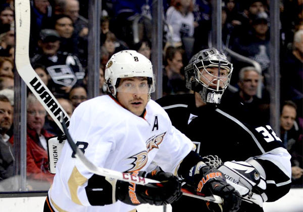 Kings goalie Jonathan Quick, right, and Ducks' Teemu Selanne meet behind the net during a game in February.