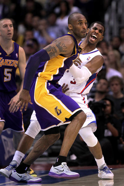 Clippers point guard Chris Paul reacts after getting fouled by Lakers guard Kobe Bryant in the fourth quarter Sunday afternoon.