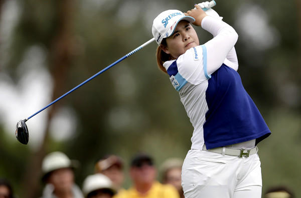Inbee Park follows through on her tee shot at No. 3 on Sunday during the final round of the Kraft Nabisco Championship.