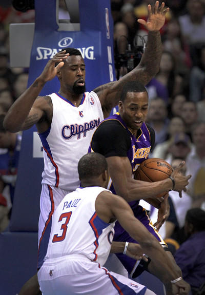 Clippers center DeAndre Jordan and point guard Chris Paul double team Lakers center Dwight Howard during their game Sunday afternoon.