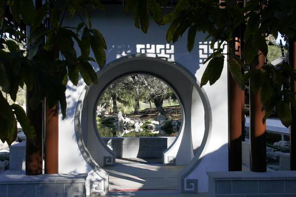 "The ""moon gates"" of the Jade Mirror terrace frame views of the Chinese Garden at the Huntington Botanical Gardens."