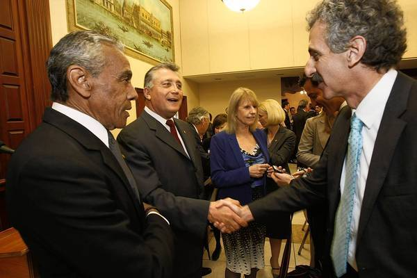 Los Angeles City Atty. Carmen Trutanich shakes the hand of his challenger, Mike Feuer, before a debate March 20.