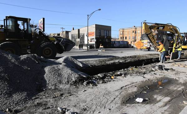 The city water department and Peoples Gas work simultaneously Friday at Madison Street and Kostner Avenue. The work was coordinated to minimize disruptions and pavement cuts.