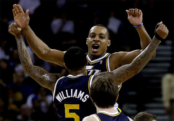 Utah Jazz' Mo Williams (5) and Randy Foye celebrate during the final seconds of Utah's win over Golden State.