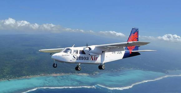 A Samoa Air flight cruises over the coast of Savaii