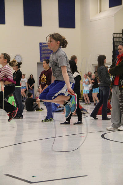 Hanna Masters, a fourth-grader at C.C. Lee Elementary, does a double jump.