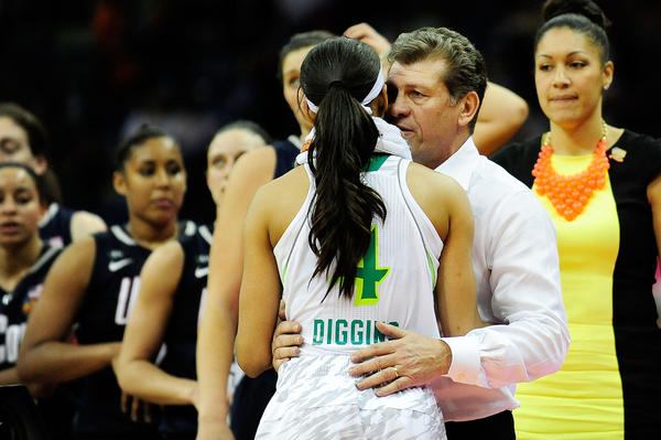 Skylar Diggins of Notre Dame is embraced by UConn coach Geno Auriemma after Monday's semifinal.