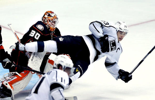Kings right wing Dustin Brown goes horizontal in front of Anaheim Ducks goalie Viktor Fasth in the third period.
