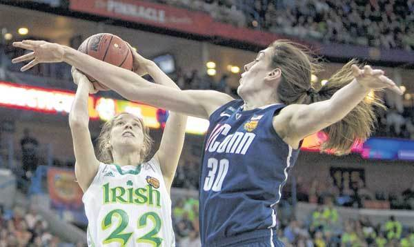 Notre Dame's Madison Cable, left, takes a shot next to Connecticut's Breanna Stewart during Sunday's Final Four semfinal in New Orleans.