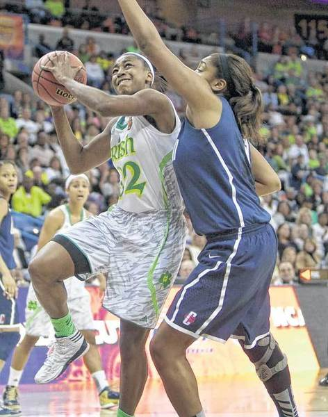 Notre Dame's Jewell Loyd goes up for a layup next to Connecticut's Morgan Tuck during Sunday night's Final Four semifinal in New Orleans Arena.