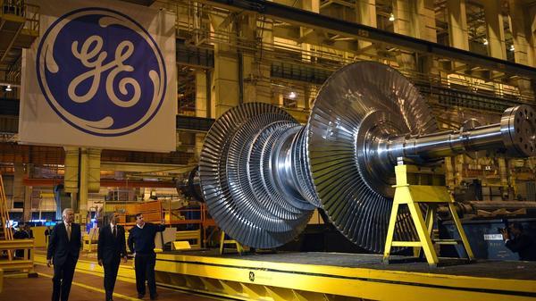 President Barack Obama looks at a turbine during a tour of the General Electric plant in Schenectady, N.Y. with GE CEO Jeffrey Immelt and plant manager Kevin Sharkey in 2011.