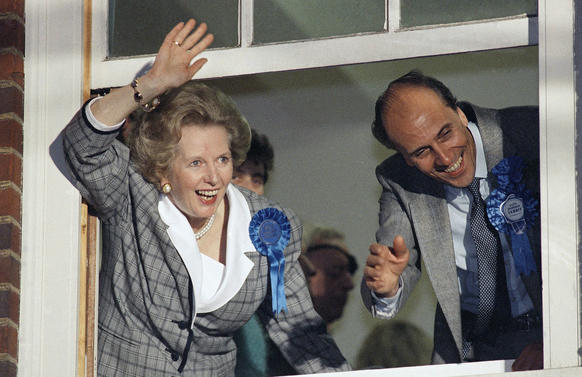 British Prime Minister Margaret Thatcher waves to supporters from Conservative Party headquarters in London after claiming victory in Britain's general election in June 1987.