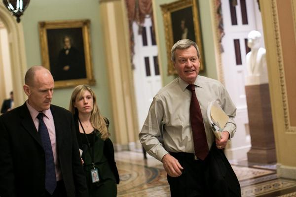 Sen. Max Baucus (D-Mont.) walks toward the Senate chamber.