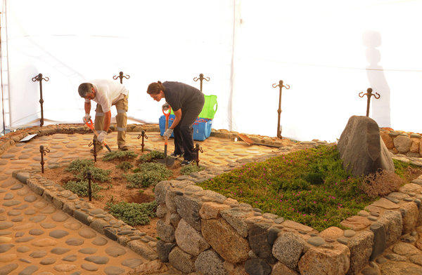 Forensic specialists dig at the grave of Nobel laureate Pablo Neruda on Sunday as they prepare for the exhumation of the remains in Isla Negra, Chile.