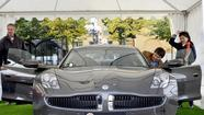 Stymied by unsuccessful efforts to craft a deal with Chinese investors to save the company, struggling carmaker Fisker Automotive laid off most of its workers Friday.