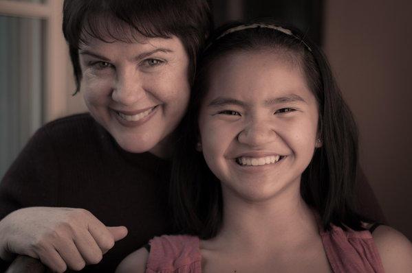 Writer-comedian Julia Sweeney and her daughter Mulan.