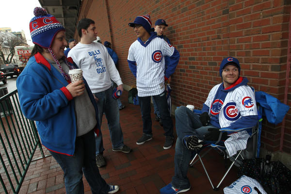 Brother and sister, Sonny and Michelle Boyer, wait in line to get bleacher seats for the Cubs home opener.
