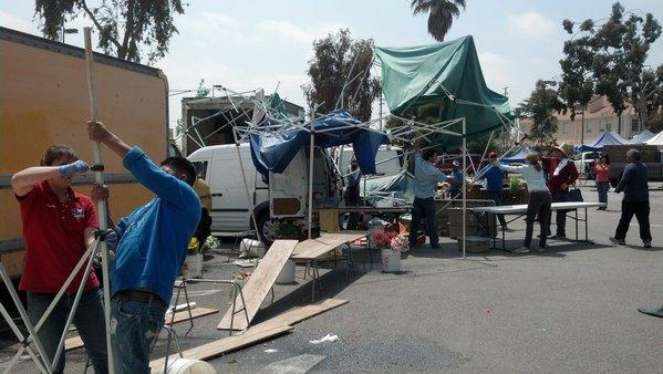 Pasadena farmers market vendors clean up after Saturday's whirlwind.