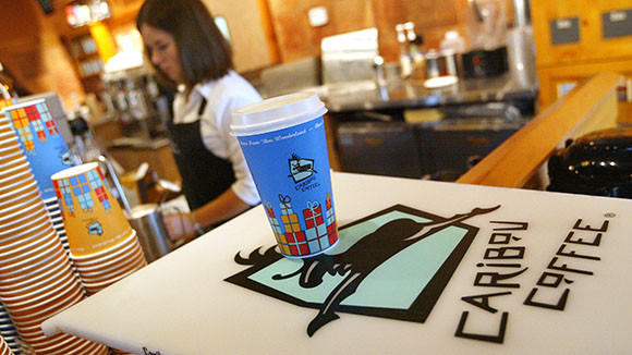 A new latte awaits its pickup in a Caribou Coffee store in Mount Prospect, Ill.