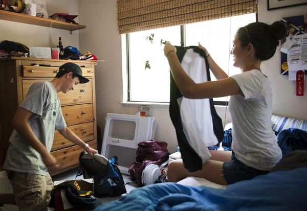 Nolan Wong, left, packs for his sophomore year at UC Berkeley with help from his sister, Delaney, who will be a freshman at UC Santa Cruz.