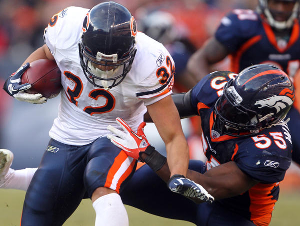 Denver Broncos outside linebacker D.J. Williams tackles Chicago Bears running back Kahlil Bell during a 2011 game.